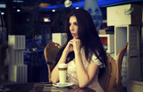 Sad woman sitting in cafe alone - 175247753