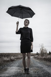 Young woman with the umbrella - 175262595