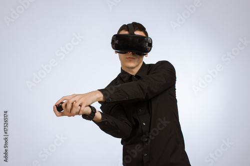 Fotobehang Tennis Young Man in Virtual Reality Headset Playing Tennis With Racquet