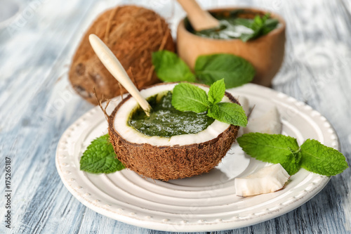 Fotobehang Kruiden 2 Half of coconut with chutney mint sauce on plate