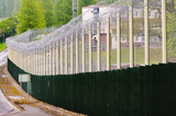 Prison fence with coiled razor wire and CCTV Cameras - 175270711