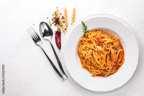 Ala Alio Pasta. On a wooden background. Top view. Free space for text.