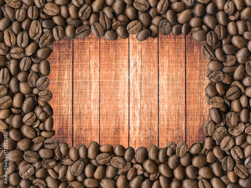 Fotobehang Koffiebonen Background. Coffee beans on wooden table