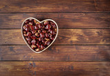 Chestnuts on wooden table - 175274946