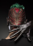 Hair style for Halloween party. Rear view of man with skull makeup and hair colored in bright colores. - 175276981
