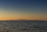 silhouette of santorini island seen from the sea. With sunset. - 175278141