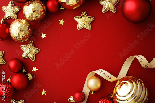 red and gold christmas ornaments frame background