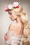 Beautiful woman portrait with long blonde hair and flowers on head. Tender bride.  - 175284739