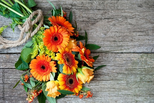 Aluminium Gerbera orange flowers on a wooden background