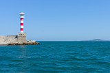 Lighthouse at the entrance to the water area of the sea port of Burgas. Bulgaria. - 175287569