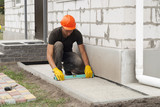 laying of paving slabs - 175288187