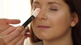 Cosmetic and beauty procedures. Closeup woman face painting. Makeup artist applying loose powder to model skin under eyes 4K ProRes HQ codec - 175292378