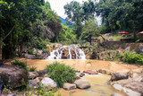 Small Waterfall among Stones in Tropical Park - 175293959