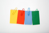 Multcolored labels with paper clips on a white background - 175294940