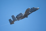 A-10 Thunderbolt II in a very fast pass,  with condensation trails at the wing edges and root - 175301988