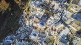 Aerial top view of white houses and church in Oia, Santorini Island, Greece