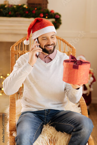 Pleasant man thanking for present on the phone Poster