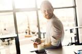 Busy businessman on a coffee break - 175321993