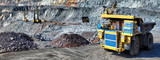 Heavy dump truck carrying the iron ore on the opencast mining - 175323503