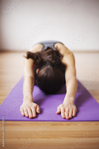 Plakat Beautiful and healthy woman in sportswear doing yoga in light room