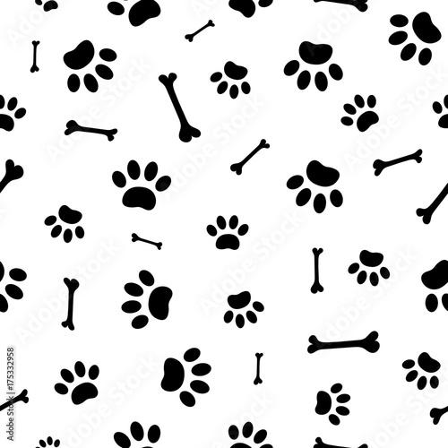 fototapeta na ścianę Seamless pattern of black paw prints and bones.