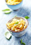 Dried pasta (farfalle) in a ceramic bowl - 175338338