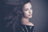 beautiful young brunette woman with hair in motion studio - 175340577