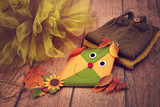 Toy kite, autumn leaves, tulle and knitted baby clothes - 175341188