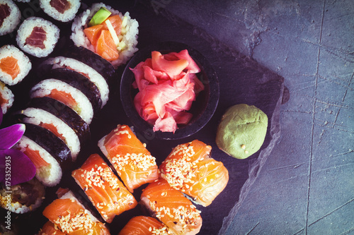 Foto op Canvas Sushi bar Japanese sushi big set with vasabi, top view, retro toned