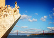 The Monument to the Discoveries in Lisbon and bridge of 25th April, Lisbon, Portugal, retro toned