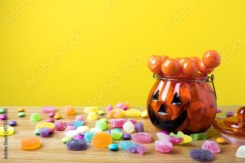 orange pumpkin pot cup glass with dessert lollipop in halloween party concept