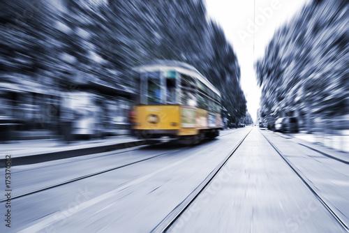 Poster Milan Blurred movement of a Old vintage orange tram