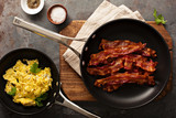 Cooked bacon on a skillet - 175370784