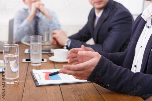 Hands, documents, diagrams on desk