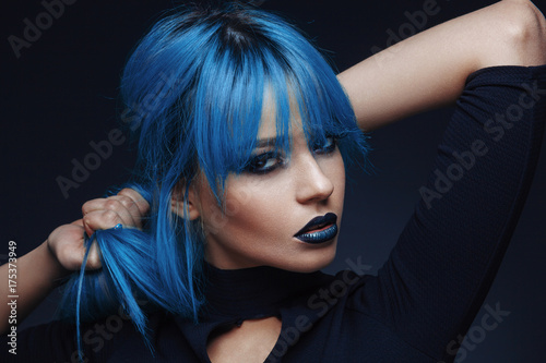 Fotobehang Kapsalon Portrait of a young woman with blue color hair