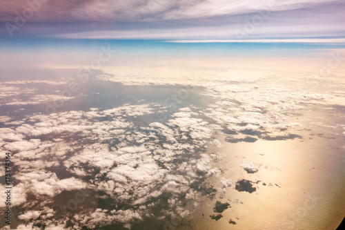 Sky and clouds from aircraft window - 175374364