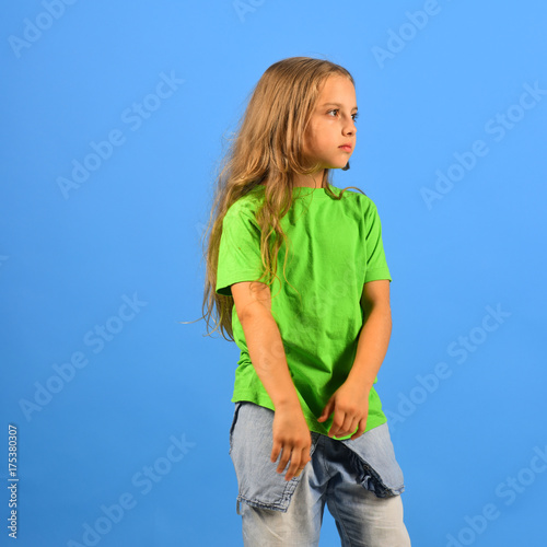 Child looks like hip hop star wearing casual clothes. Poster