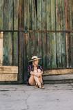 Woman siting at barn door - 175387196