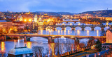 Fototapety Classic view of Prague at Twilight, panorama of Bridges on Vltava, view from above, beautiful bridges vista. Winter scenery. Prague is famous and extremely popular travel destination. Czech Republic.