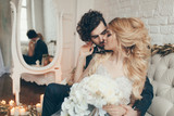 wedding in European style, beautiful couple in the Studio with a small dog - 175388915