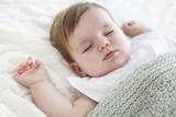 Close up portrait of a beautiful sleeping baby on white - 175392102