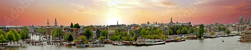 Foto op Aluminium Panoramafoto s Panorama from the city Amsterdam in the Netherlands at sunset