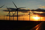 Many wind turbines or wind farm at sunset  - 175403797