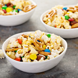 Homemade trail mix with chocolate candy, popcorn, pretzels and nuts - 175406129