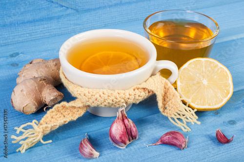 Cup of tea with lemon and ingredients for preparation warming beverage for autum Poster