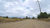 Driving in rural area of Western Colorado on cloudy day - 175421320