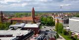 Fototapeta City - Panorama Legnicy - widok na parking na dachu galerii, wieżę zamkową oraz przekaźnik radiowo-telewizyjny © Konrad_elx