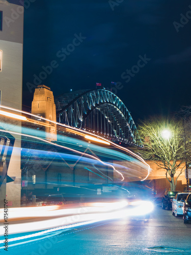 Trails of car light with Sydney Harbour Bridge on the background. Poster