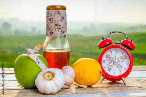 Fresh organic honey in glass jar , measuring tape, green epal , lemon ,garlic an Poster