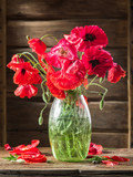 Bouquet of poppy flowers in the vase on the wooden table. - 175438707